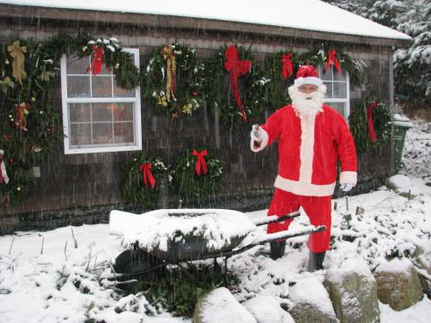 santa in front of the wreaths